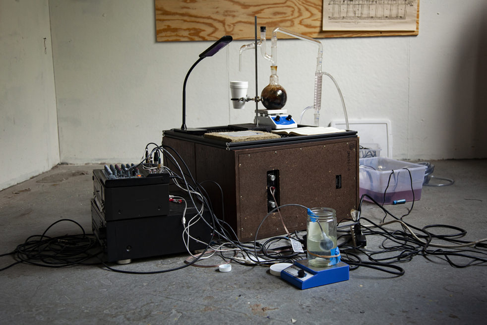 Science experiment on desk in middle of bare room