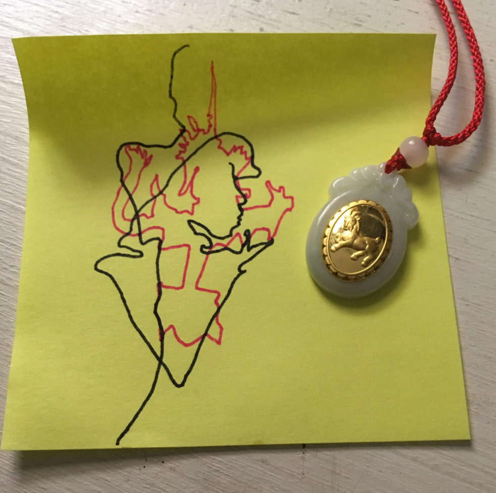 Abstract drawing with gold pendant on top